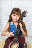 Little girl playing the guitar Royalty Free Stock Photography