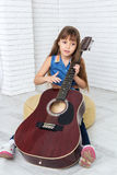 Little girl playing the guitar Stock Photos