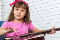 Little girl playing the guitar Stock Photography