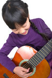 Little girl playing guitar Royalty Free Stock Photo