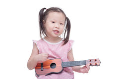 Little girl playing guitar toy Royalty Free Stock Photo