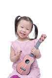 Little girl playing guitar toy Stock Photos
