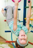 Little girl at gymnastic rings Stock Photography