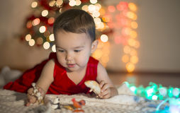 Little girl playing with her animals. In the Christmas Eve royalty free stock images