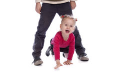 Little girl playing with her big brother Stock Photography
