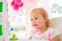 Little Girl Playing with Her Birthday Present Royalty Free Stock Photo