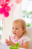 Little Girl Playing with Her Birthday Present Royalty Free Stock Images
