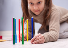 Little girl playing with her coloured felt-tip pens Stock Image