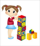 Little girl playing with her cube alphabet Stock Photos