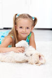 Little girl playing with her dog Royalty Free Stock Photos