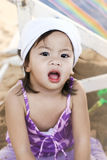 Little girl playing and her face dirty with sand Stock Photography