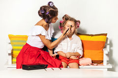 Little girl playing with her mom's makeup Stock Image