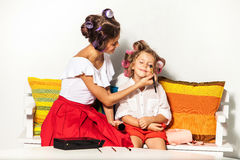 Little girl playing with her mom's makeup Stock Photography