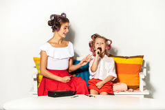 Little girl playing with her mom's makeup Stock Photo