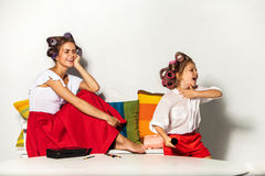 Little girl playing with her mom's makeup Royalty Free Stock Photo