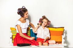 Little girl playing with her mom's makeup Stock Images