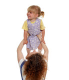 Little girl playing with her mother Stock Photo