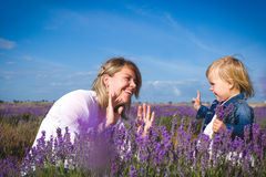 Little girl playing with her mother in lavender field Stock Image