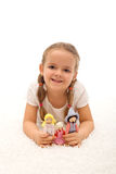 Little girl playing with her puppets family Royalty Free Stock Photography
