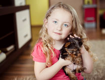 Little girl and puppy. Little girl is playing with her puppy at home Stock Image