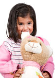 Little girl playing with her teddy Royalty Free Stock Photography