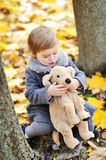 Little girl playing with her toy in a park Royalty Free Stock Image