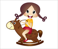 Little girl playing with her wooden horse Stock Photos