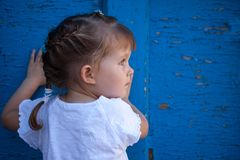 Little girl playing hide and seek stock photography
