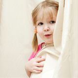 Little girl playing hide and seek Royalty Free Stock Photos
