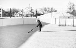 Little girl playing hockey Stock Photos