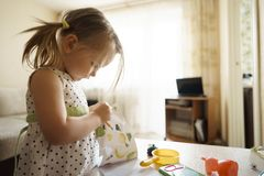 Nlittle girl playing at home with toys royalty free stock images