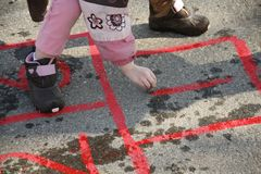 Little girl playing hopscotch Royalty Free Stock Photography