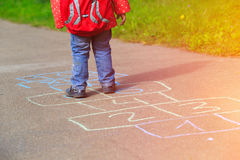 Little girl playing hopscotch game after school Stock Image