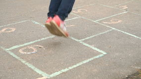 Little girl playing hopscotch at the kindergarten stock video