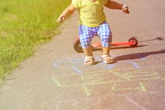 Little girl playing hopscotch on playground Royalty Free Stock Image
