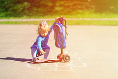 Little girl playing hopscotch on playground Royalty Free Stock Photos