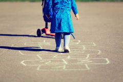 Little girl playing hopscotch on playground Royalty Free Stock Photography