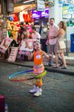 Little girl playing with hula hoop. Royalty Free Stock Image