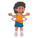 Little girl playing hula hop Stock Photo