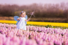 Little girl playing in hyacinth field Stock Image