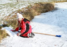 Little girl playing on iced pond Royalty Free Stock Photography