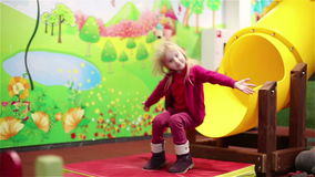 Little girl playing on the indoor playground. stock video footage