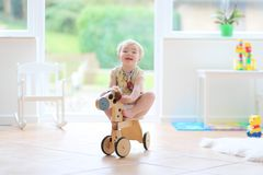 Little girl playing indoors Stock Photography
