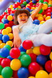 Little girl playing in inflatable bouncing castle Stock Photo