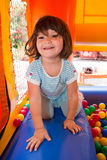Little girl playing in inflatable bouncing castle Royalty Free Stock Photography