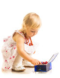 Little girl playing with jewelry box on a white background. Stock Image