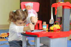 Little girl playing in a kindergarten Stock Photography