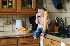 Little girl playing in the kitchen Royalty Free Stock Photography