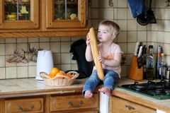 Little girl playing in the kitchen Royalty Free Stock Photos