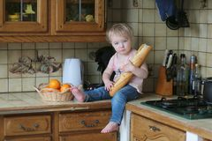 Little girl playing in the kitchen Stock Photo